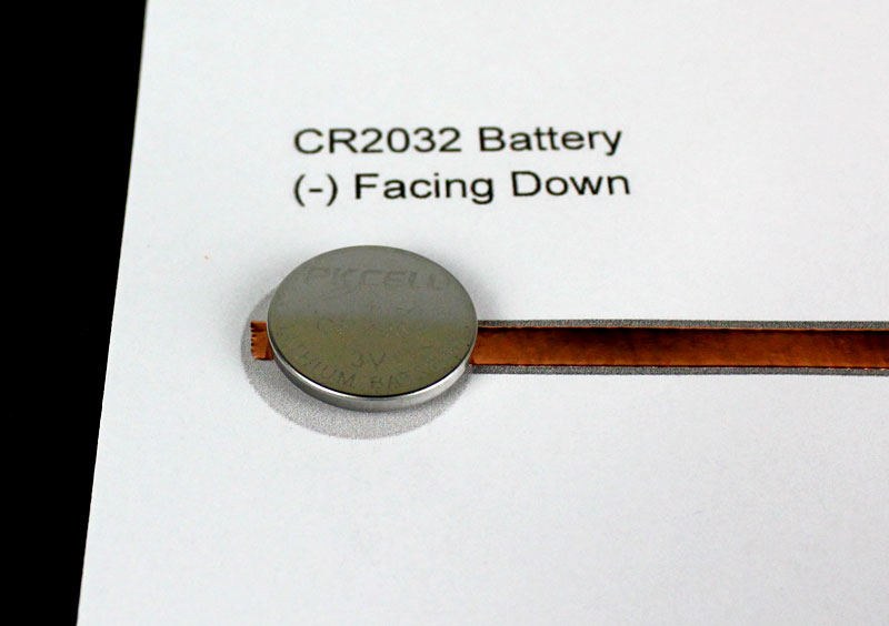 attach coin cell battery to template